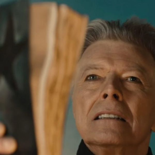 David Bowie holding a bible