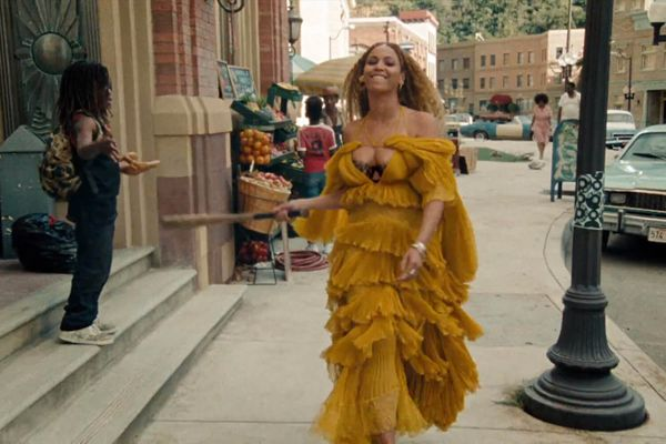 "Beyonce Knowles in a bright yellow dress for the music video of her song ""Hold Up"""