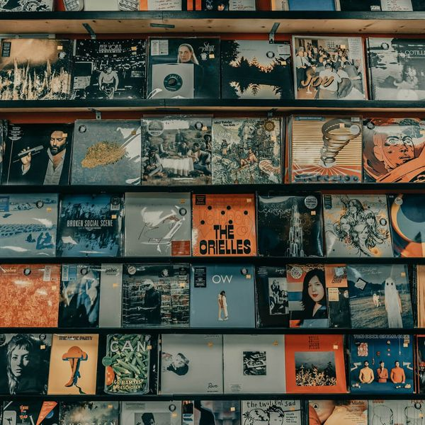 A wall covered with vinyl record sleeves