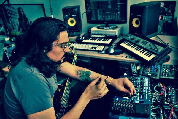 Paul Marchesani working in his music studio